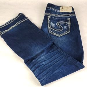 Women's Silver destroyed blue jeans